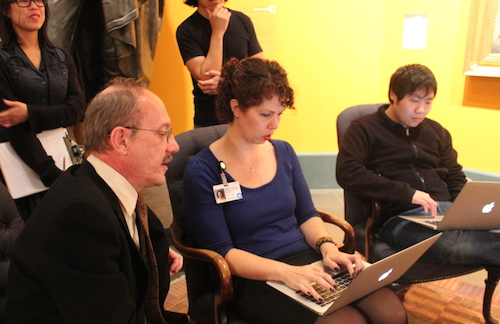Kevin Stayton, chief curator answering visitor questions with Sara Devine typing them on the ASK dashboard.