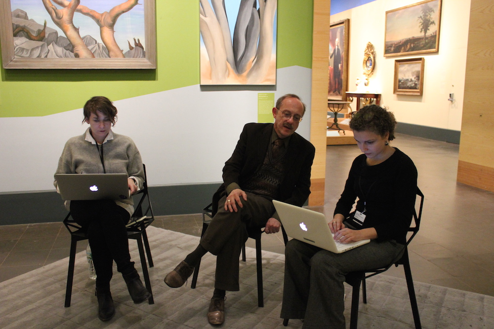 Monica Marino, left, and Marina K, right, running the dashboard during a recent user testing session. Our Chief Curator, Kevin Stayton, helps answer questions.