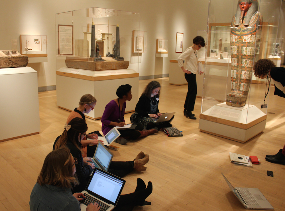 The Audience Engagement team working in the Egyptian galleries to write wiki content.