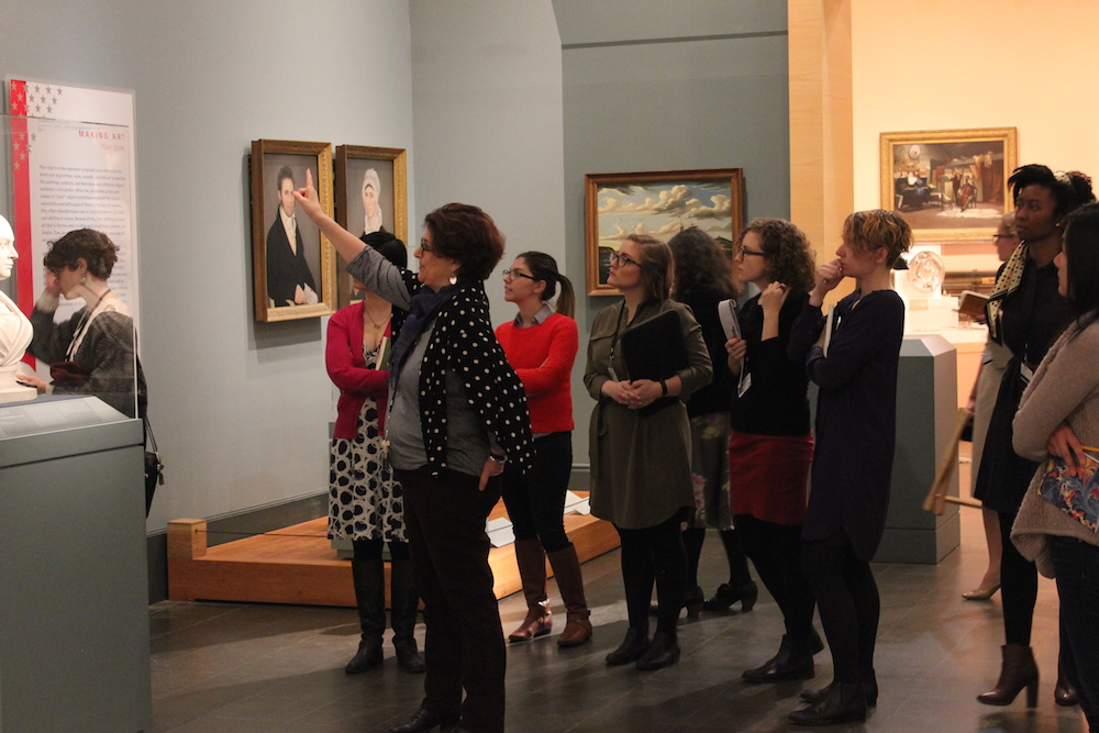 As part of training, our Audience Engagement team is walking through the galleries with each collection curator. Here they are getting a tour through American Art with Terry Carbone.