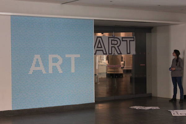 """New graphics and adjustments to existing graphics help guide visitors. In the case shown here, our old """"art,"""" """"shop,"""" and """"eat"""" are being moved from walls to the actual doorways. Additionally, they are reoriented higher so they are visible over people's heads."""