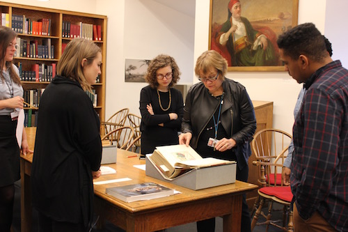 Deirdre Lawrence, Principal Librarian at the Brooklyn Museum, shows us some archival materials.