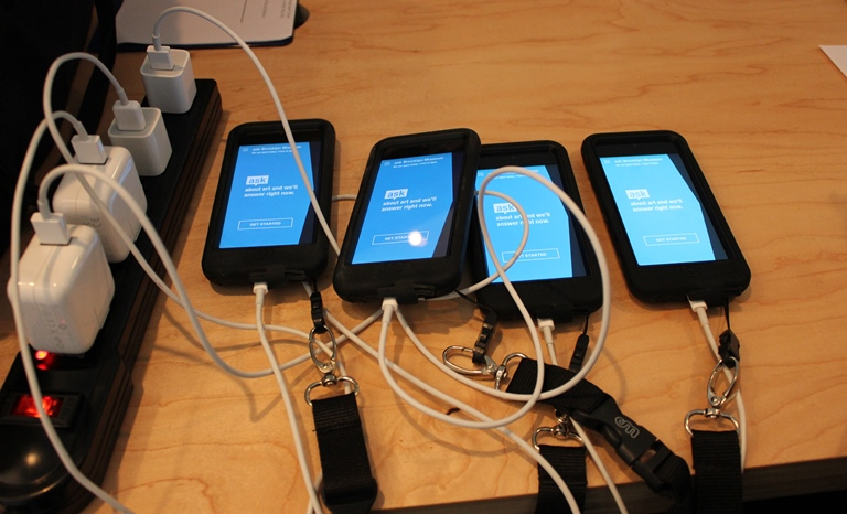 """Seems fitting to return to iPod touches for this pilot since that's what we used for our pilot that ultimately led us to create ASK. Here we set them up with lanyards and protective cases. We enabled """"guided access mode"""" to lock them down on the app only."""