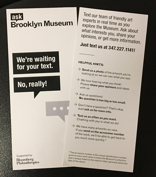 "Our texting palm card included the phone number as well as ""helpful hints"" on what kinds of things to text. Unlike the app (which is geo-fenced), in theory you can text us anytime, but we won't answer outside of Museum hours. The system will autofire the same ""out of office"" notification"" app users also get."