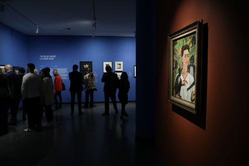 """The """"no photography"""" policy within the exhibition meant that visitors were looking for another way to remember their favorite works in the show. (Photo: Jonathan Dorado)"""