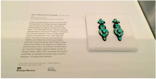 The prompt for this ASK label reads: Curious about how turquoise was used in Tibetan medicine? Download our app to ask an expert.